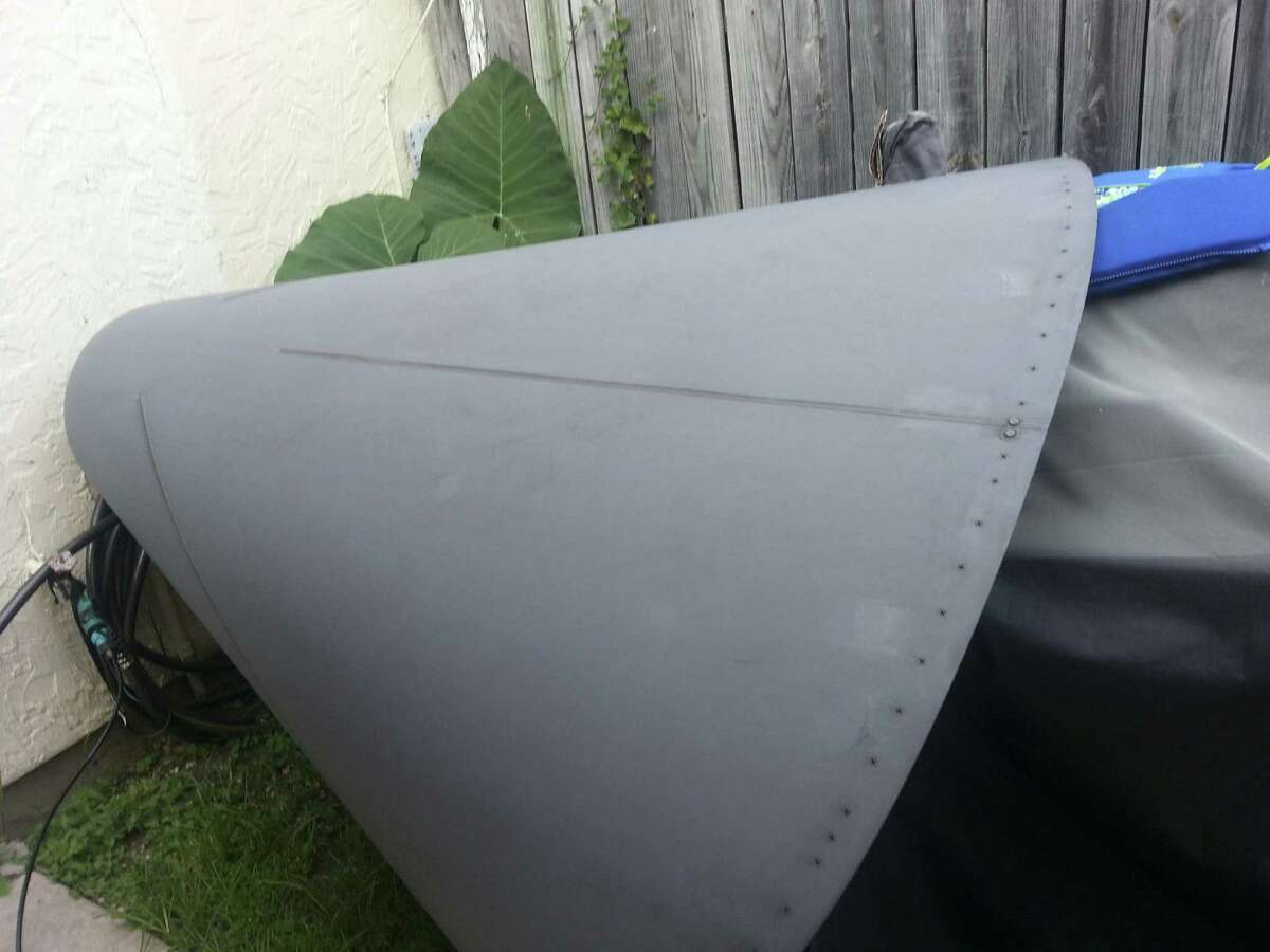 A piece from a C-17 military plane fell into a backyard of a home in the 6500 block of Spring Hurst Drive.