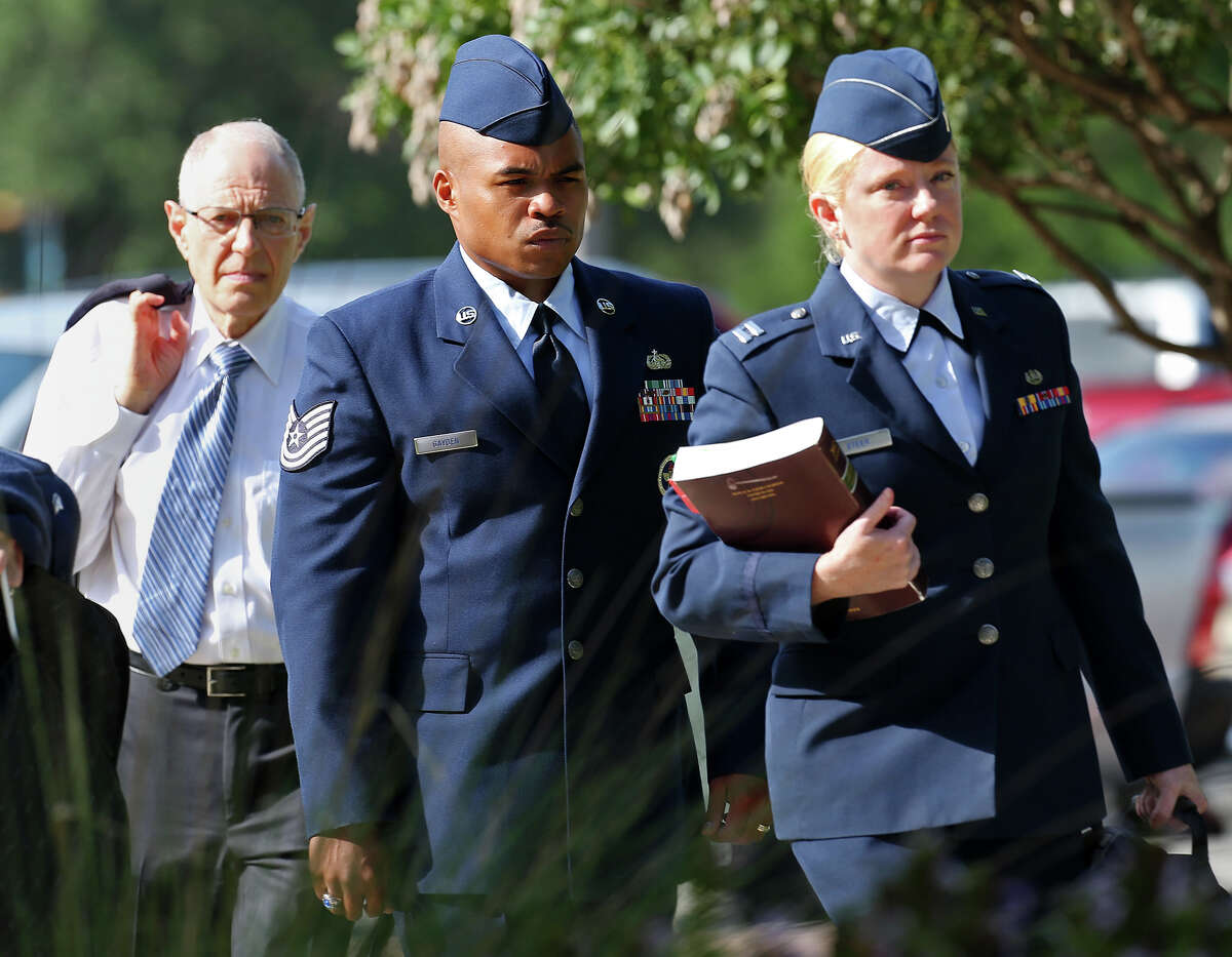 Tech. Sgt. Marc Gayden, center, arrives at Lackland Air Force Base for his trial on sodomy and rape charges, Tuesday, July 23, 2013.
