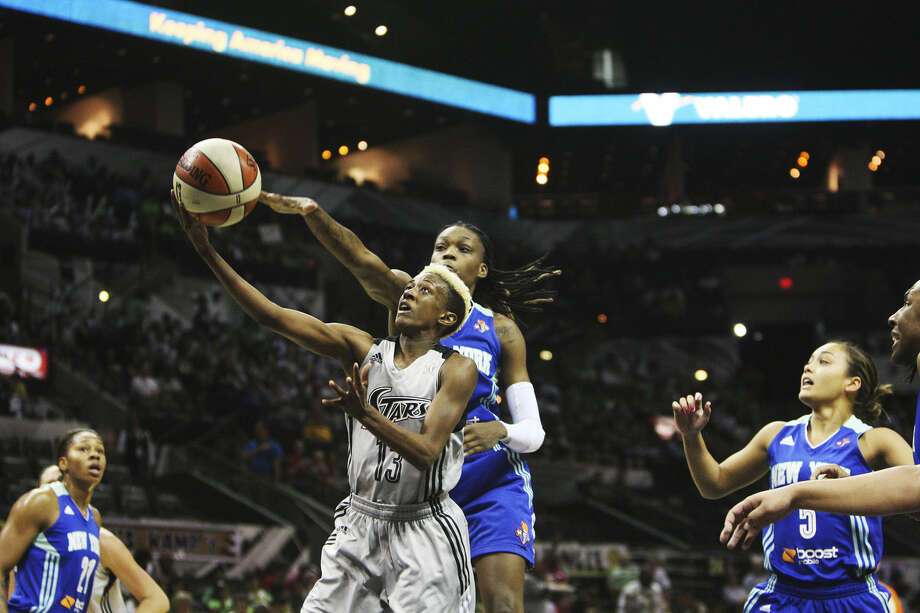 Danielle Robinson of the Silver Stars goes for a layup as Toni Young of the Liberty tries to stop her. Robinson had 17 points, six assists and six boards. Photo: Abbey Oldham / San Antonio Express-News