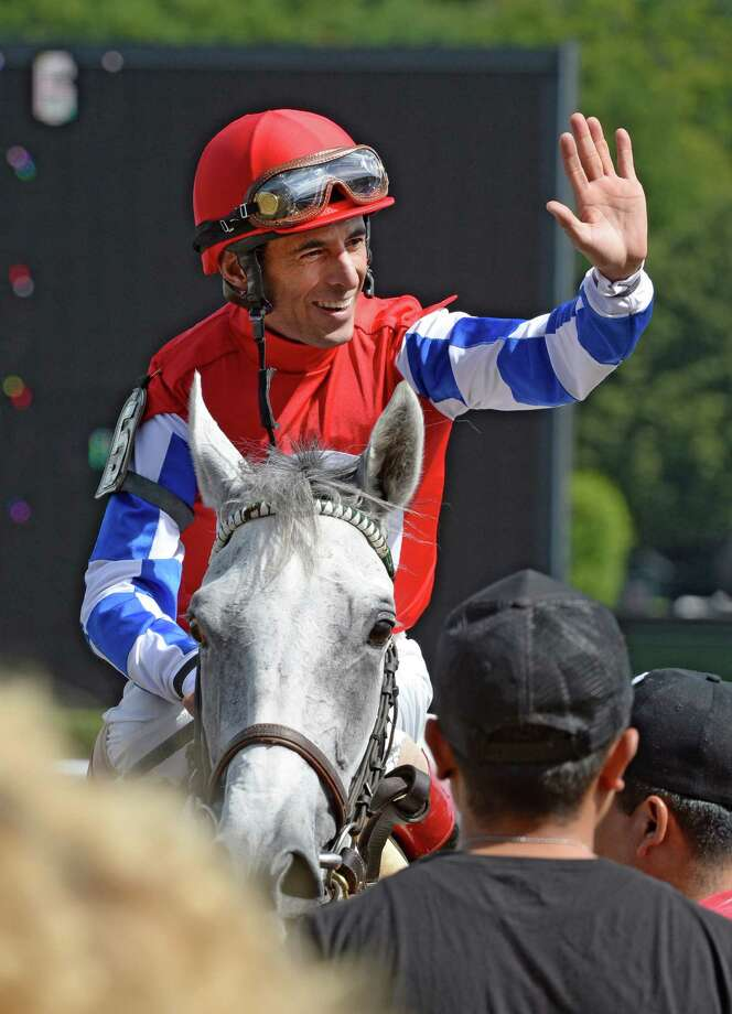 Jockey John Velazquez equals the all-time winning jockey record at Saratoga Race Course after taking White Rose to victory in the 6th race of the day Thursday afternoon, July 25, 2013, at Saratoga Race Course in Saratoga Springs, N.Y. He is now tied with Jerry Bailey with 693 wins at the Spa. (Skip Dickstein/Times Union) Photo: SKIP DICKSTEIN