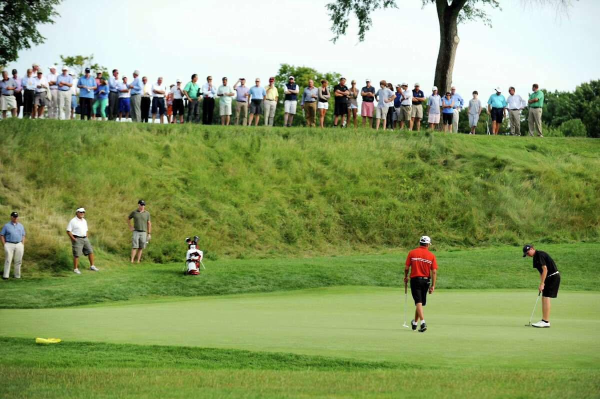 Victor Fox of Normanside Country Club, center, and Matt Stasiak of Fox Valley Club, right, evaluate the 17th green before putting during the State Amateur golf tournament on Thursday, July 25, 2013, at Schuyler Meadows Club in Loudonville, N.Y. (Cindy Schultz / Times Union)