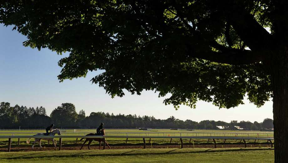 Horses are worked out at the Oklahoma Training Center Thursday morning, July 25, 2013, in Saratoga Springs, N.Y.  (Skip Dickstein/Times Union) Photo: SKIP DICKSTEIN