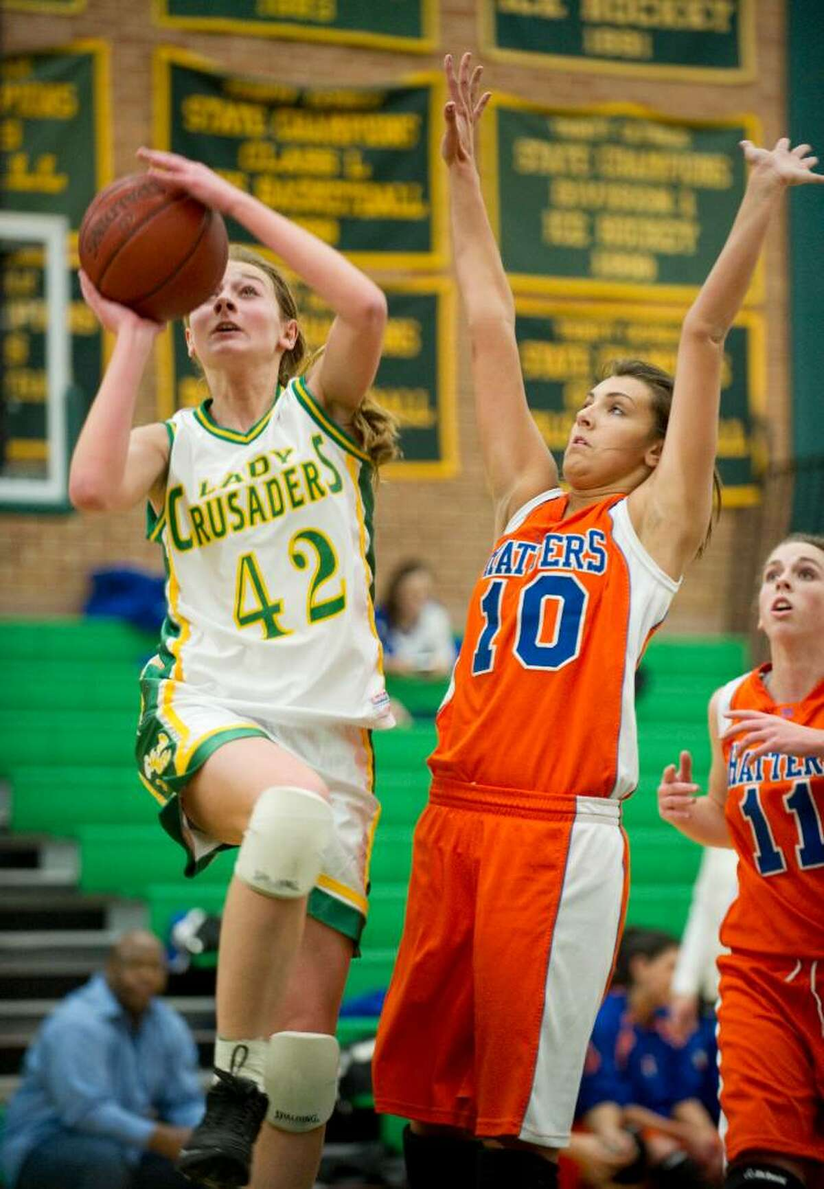 Trinity's Mackenzie Griffin, left, shoots while defended by Danbury's Casey Smith, right, during an FCIAC girls basketball game at Trinity Catholic High School in Stamford, Conn. on Tuesday, Jan. 109, 2010.