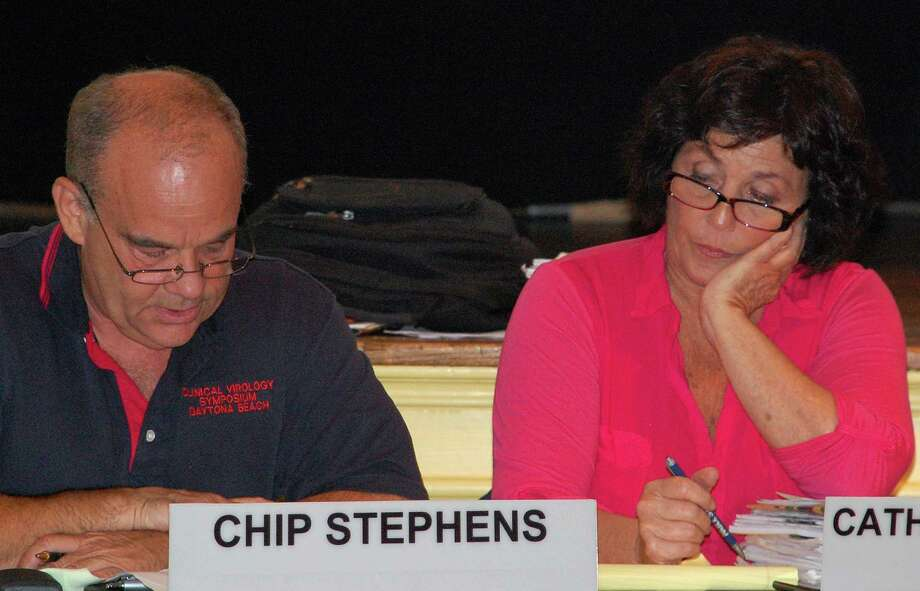 Planning and Zoning Commission member Chip Stephens on Thursday reads from the 2009 approval granted by the panel to Beit Chaverim Synagogue for a new house of worship on Ludlow Road. The congregation, however, did not build that project and is now seeking P&Z approval for a revised now. Catherine Walsh, the P&Z chairwoman, listens.  WESTPORT NEWS, CT 7/25/13 Photo: Jarret Liotta / Westport News contributed