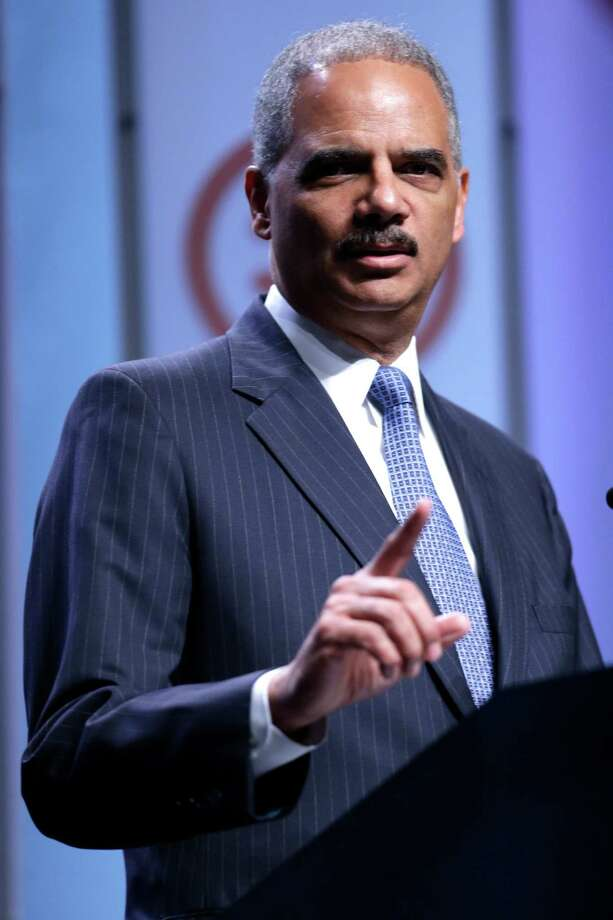 Attorney General Eric Holder speaks at the National Urban League annual conference, Thursday, July 25, 2013, in Philadelphia.  Holder announced Thursday the Justice Department is opening a new front in the battle for voting rights in response to a Supreme Court ruling that dealt a major setback to voter protections.  (AP Photo/Matt Rourke) Photo: Matt Rourke, STF / AP
