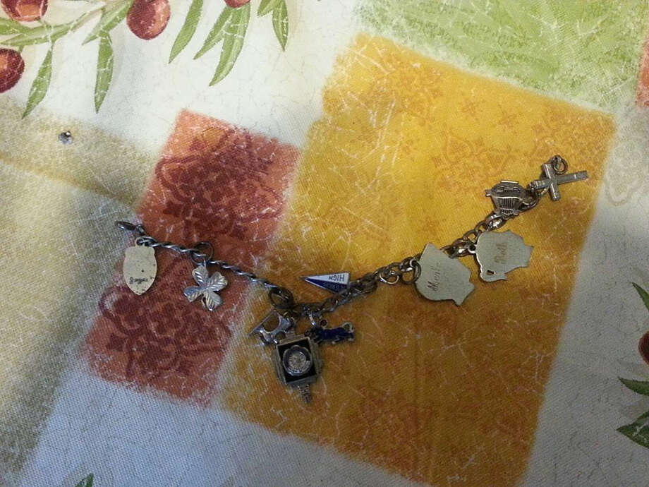 This charm bracelet, stolen in 1973, made it's way to Crystal Beach where a Winnie resident found it in the mid 1990s. The bracelet has been mailed back to it's rightful owner, who lives more than 750 miles away in Americus, Ga. Photo: Joan Mitchell
