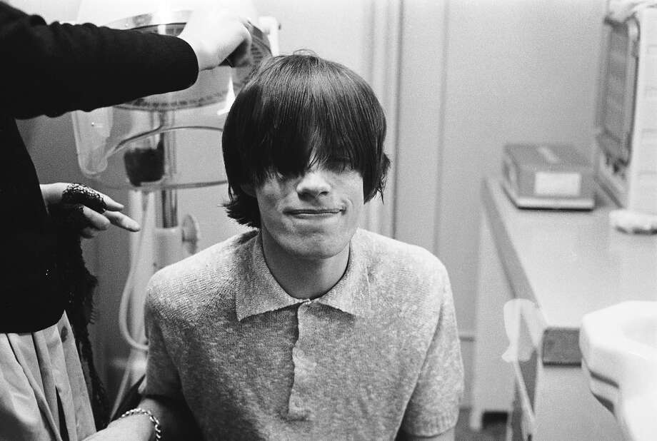 Singer Mick Jagger having his hair styled at the BBC studios before an appearance on television, 1963. Photo: Terry O'Neill, Getty Images / 2004 Getty Images