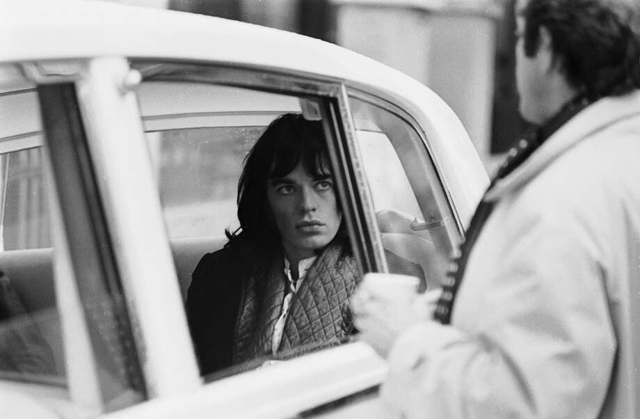 Mick Jagger of the Rolling Stones borrows a Rolls Royce from John Lennon for a scene in the Nicolas Roeg film 'Performance' in 1968. Photo: Joe Bangay, Getty Images / Hulton Archive
