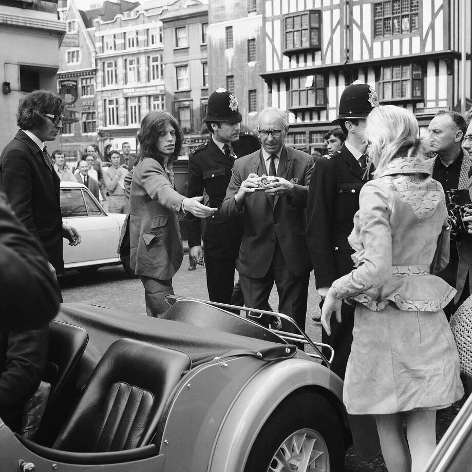Rolling Stones singer Mick Jagger and his girlfriend, singer and actress Marianne Faithfull, at Marlborough Street magistrates to answer charges relating to a drugs raid at their Chelsea home, 29th May 1969. Photo: Central Press, Getty Images / 2006 Getty Images