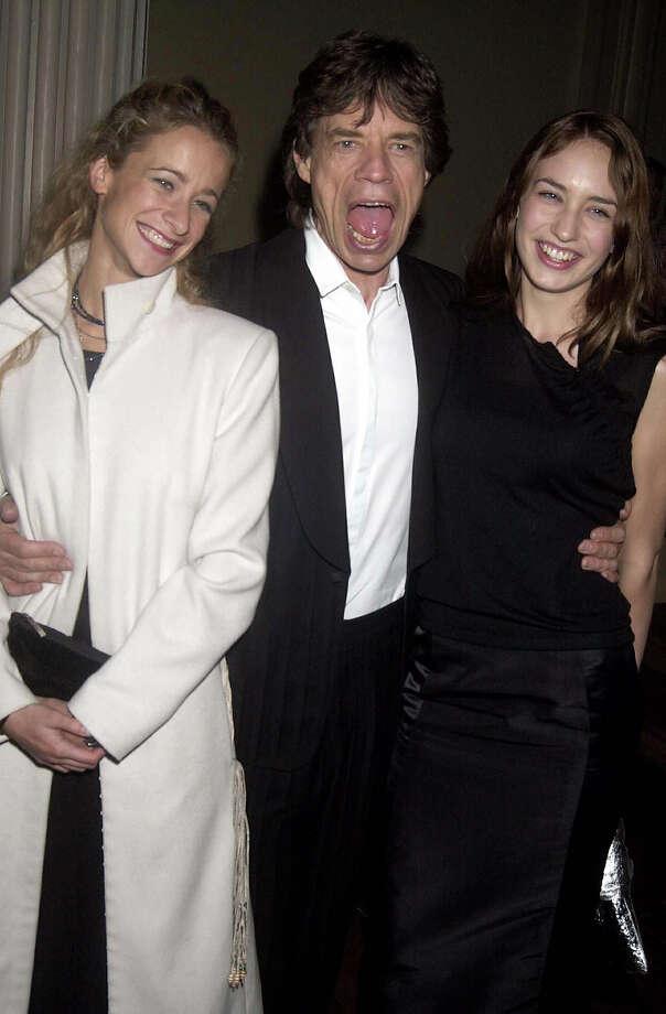 """Leah Wood, Mick Jagger & Elizabeth Jagger, """"Enigma"""" Movie Premiere Party Held At The Whitehall Banqueting Hall In London, 2001. Photo: Dave Benett, Getty Images / Hulton Archive"""