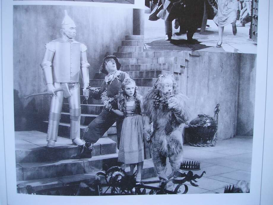 Dorothy Gale wearing the dress from the Richard Thorpe filming of the Wizard of Oz. Shown with the Scarecrow, Cowardly Lion and the Tin Man