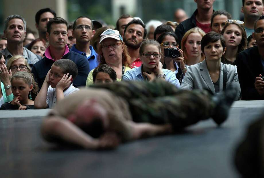 "NEW YORK, NY - JULY 25:  The public watches as a dancer playing a dead National Guard soldier performs during a presentation of choreographer Mark Dendy's ""Ritual Cyclical"", presented by Lincoln Center Out of Doors and the American Dance Festival on July 25, 2013 in New York City. Eighty artists took part in the site specific event at the Lincoln Center's Hearst Plaza in performances Wednesday and Thursday.  (Photo by John Moore/Getty Images) ORG XMIT: 174542921 Photo: John Moore, Getty / 2013 Getty Images"