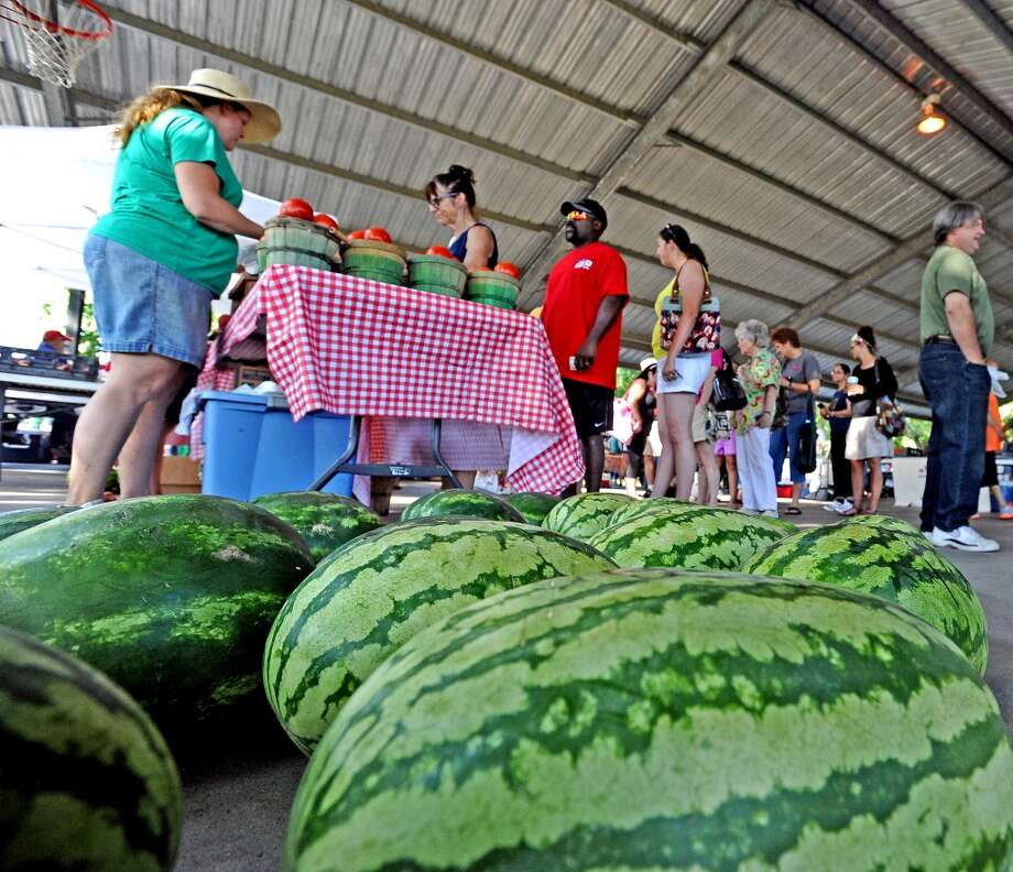 Customers wait in line for fresh produce at the Beaumont Farmers Market.  Photo taken Saturday, July 6, 2013. Photo taken: Randy Edwards/The Enterprise