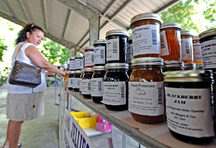 A large jelly and jam selection is browsed through at the Beaumont Farmers Market.  Photo taken Saturday, July 6, 2013. Photo taken: Randy Edwards/The Enterprise