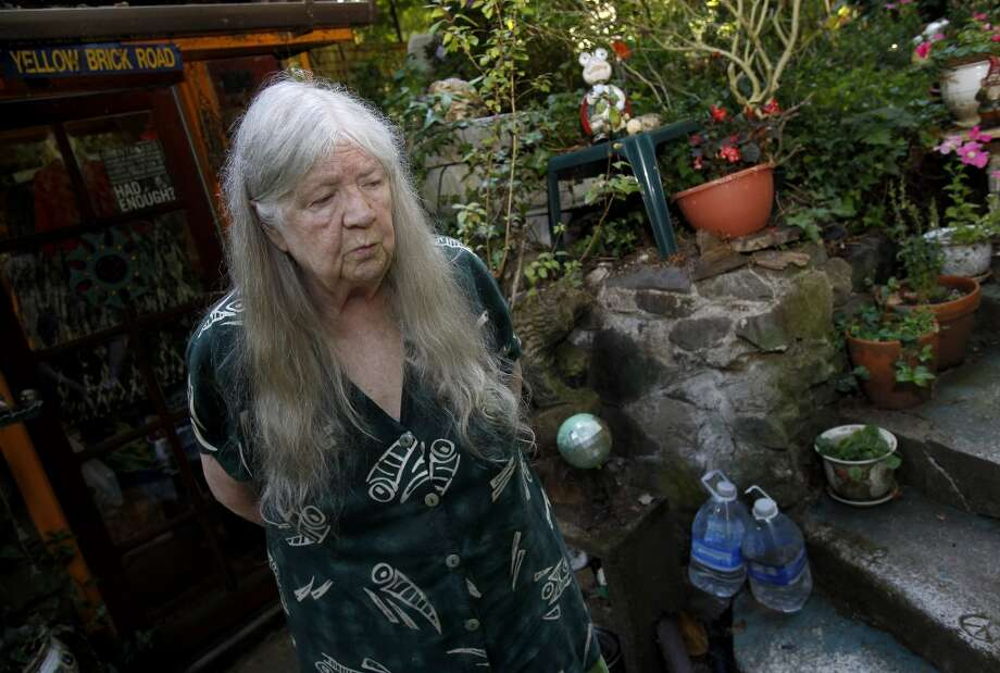 Outside her Camp Meeker home Wednesday July 24, 2013, Mary Moore plans to keep on fighting the gathering at Bohemian Grove. Mary Moore, the longtime leader of the Bohemian Grove Action Network, is boycotting her own protests because another group run by a Tea Party advocate is horning in on her territory.  Moore plans to continue to attack the rich and powerful men using writings. Photo: The Chronicle