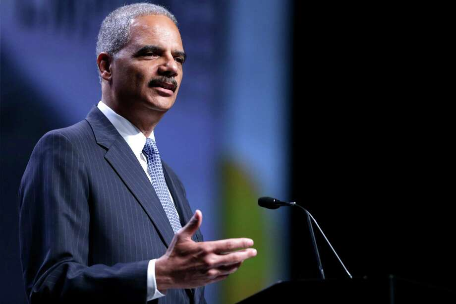 Attorney General Eric Holder speaks at the National Urban League annual conference, Thursday, July 25, 2013, in Philadelphia.  Holder announced Thursday the Justice Department is opening a new front in the battle for voting rights in response to a Supreme Court ruling that dealt a major setback to voter protections. (AP Photo/Matt Rourke) Photo: Matt Rourke, Associated Press / AP