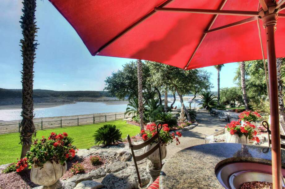 This property with more than 9 acres and views of Medina Lake is in Lakehills, northwest of San Antonio. On the market for $1.875 million, the property includes a 3,500-square-foot, three-bedroom, two-bath rock home. Photo: Courtesy Hi Energy Realty