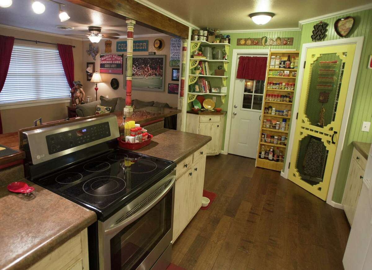 Clay and Susan Collins expanded the kitchen in the New Braunfels house where Clay grew up. They opened the space to the dining room and added a large pullout spice rack and a pantry.