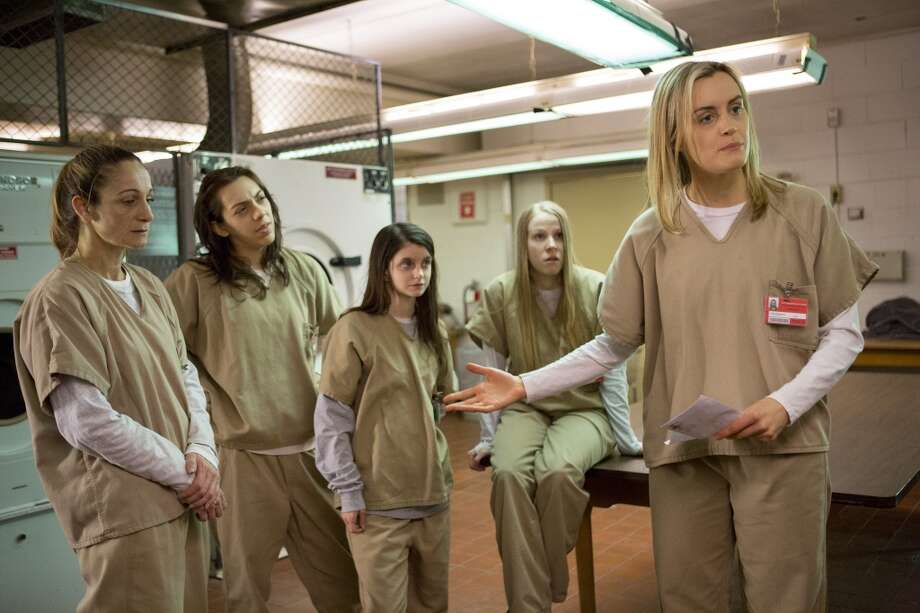 The actors in ''Orange is the New Black'' spend a lot of time wearing different versions of this outfit. Taylor Schilling is pictured, right. Photo: Netflix