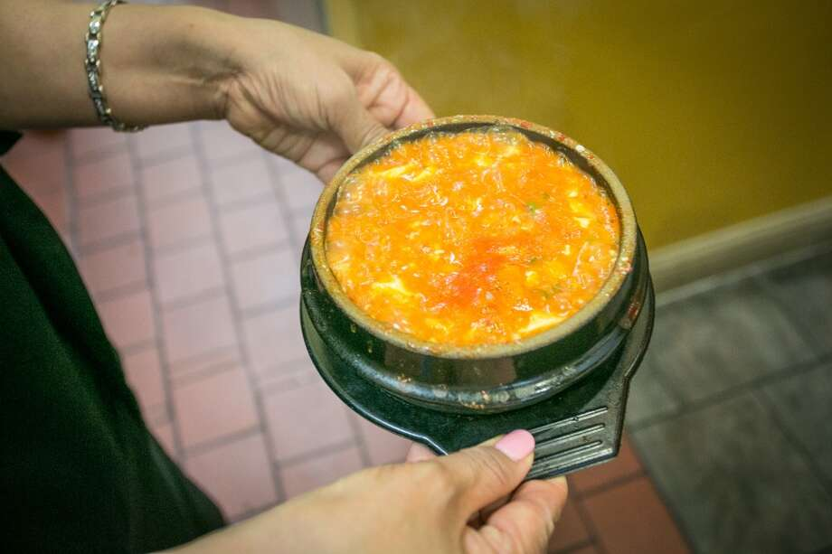 The Kimchi Soft Tofu is carried to a table at Gangnam Chicken in San Mateo. Photo: John Storey, Special To The Chronicle