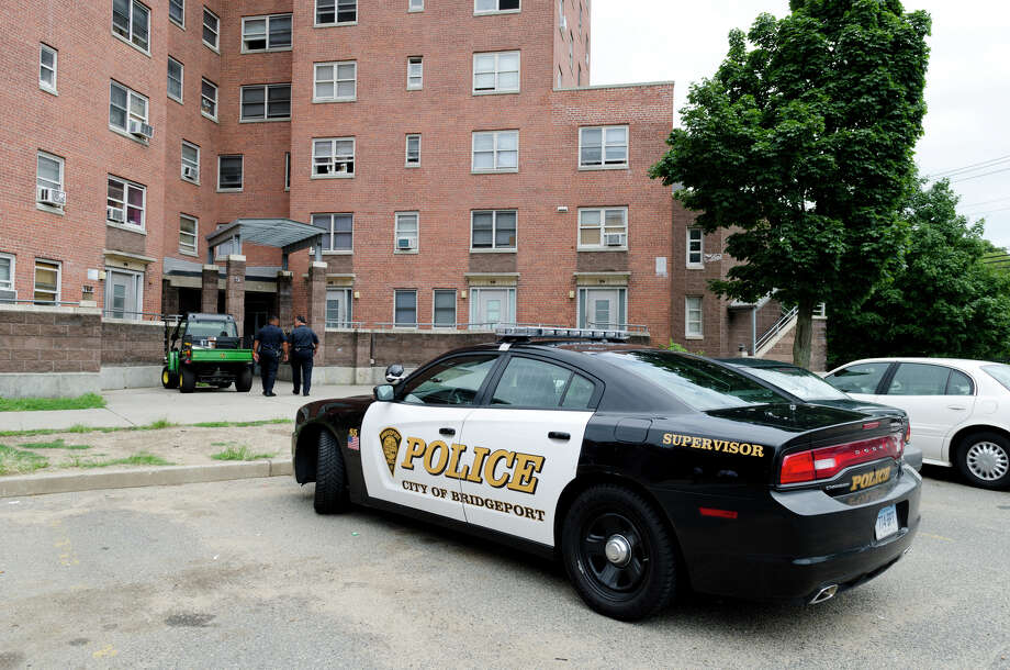 A press conference was held at the Greene Homes housing complex located on Highland Avenue in Bridgeport on Friday, July 26, 2013. The press conference was held to announce a partnership between the Bridgeport Housing Authority and the Bridgeport Police Department to promote safety with two walking-beat police officers at three Bridgeport housing complexes, Charles Greene Homes, Trumbull Gardens and P.T. Barnum Apartments. Photo: Amy Mortensen / Connecticut Post Freelance