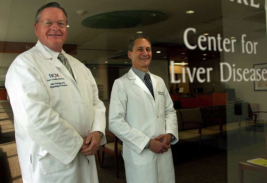 Dr. John Vierling, left, and Dr. Norman Sussman say people born from 1945 to 1965 should be tested for hepatitis C, even if no symptoms are present. Photo: Mayra Beltran, Staff / © 2013 Houston Chronicle