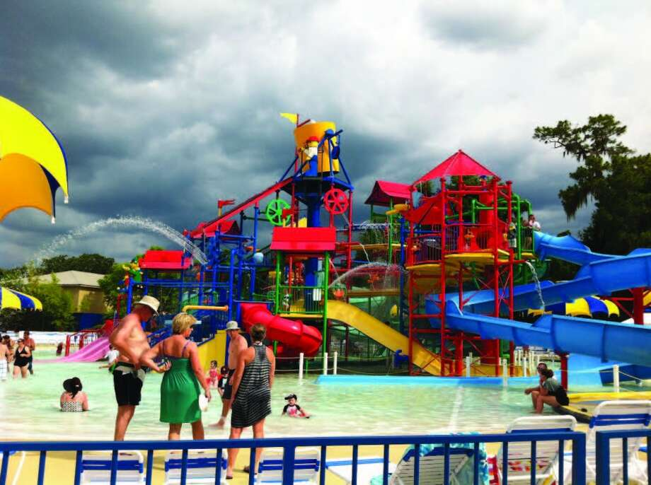 Guests play in the LEGOLAND water park in Florida as dark clouds approach. Photo: Chantay Warren, San Antonio Express-News