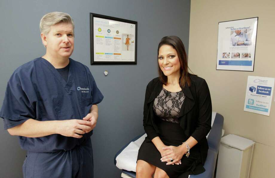 Dr. Erik Wilson confers with patient Ashley Falco during a visit to the UT Health Center. Falco lost 95 pounds after undergoing bariatric surgery in 2011. Photo: Melissa Phillip, Staff / © 2013  Houston Chronicle