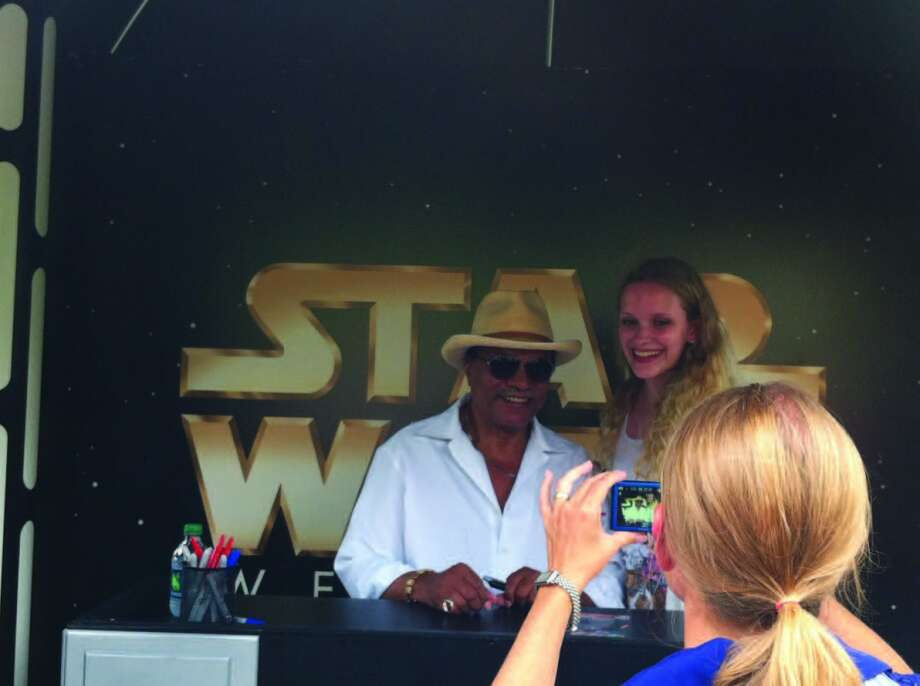 Actor Billy D. Williams is photographed with a fan during Star Wars Week at Disney World's Hollywood Studios. Yoda and others were there, too. Photo: Chantay Warren, San Antonio Express-News