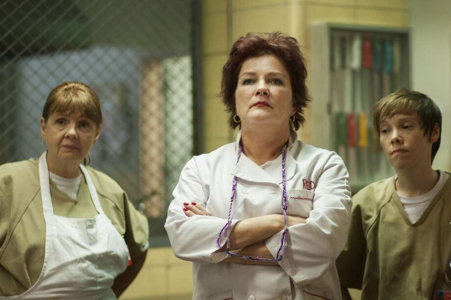 Kate Mulgrew (center),  who plays prison toughie ''Red,'' is a longtime actress who's probably best known as … Photo: Paul Schiraldi, Netflix
