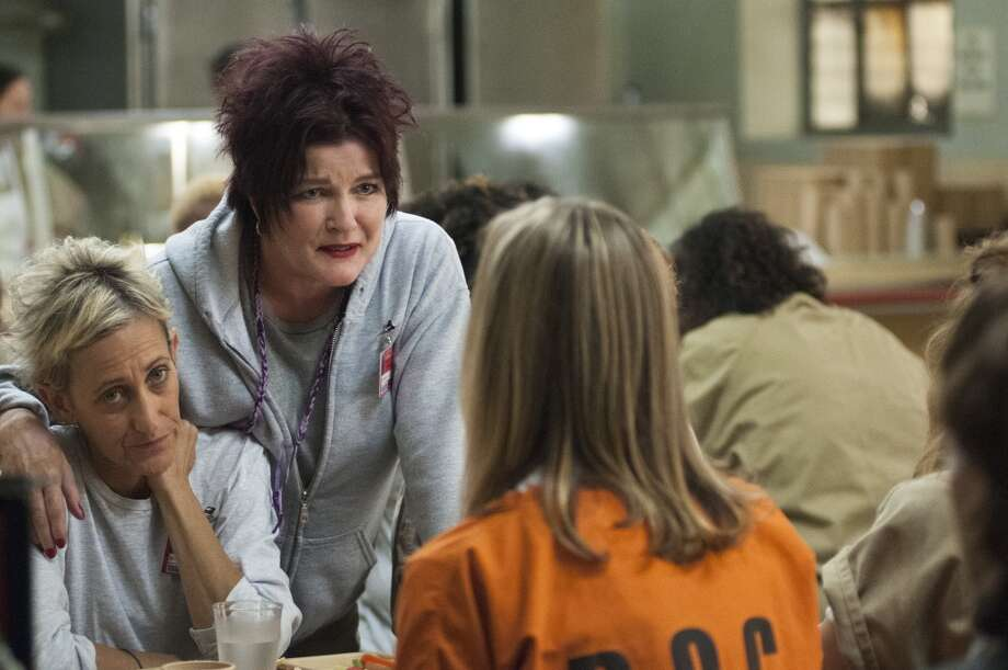 Kate Mulgrew, center, takes no baloney in ''Orange is the New Black.'' With actress Constance Shulman, left. Photo: Netflix