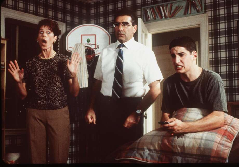 Jason Biggs, right, in a memorable scene in ''American Pie,'' with Molly Cheek, left, and Eugene Levy, center. Photo: Getty Images