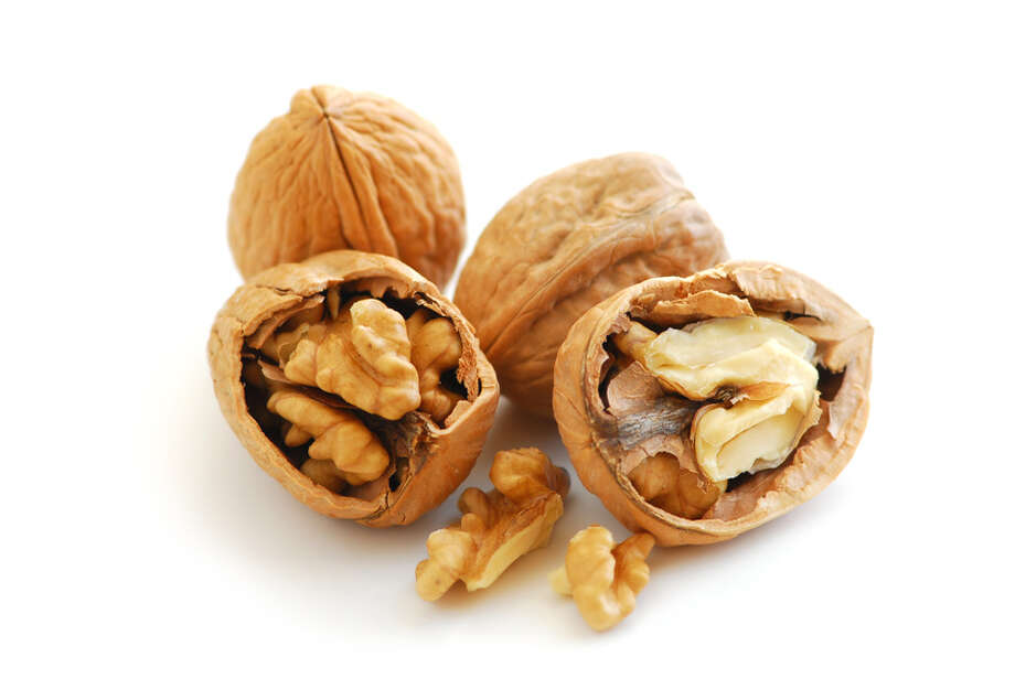 Most nuts are recognized as superfoods, thanks to a high concentration of unsaturated fatty acids, like omega-3s, which help lower cholesterol and decrease the risk of heart disease.