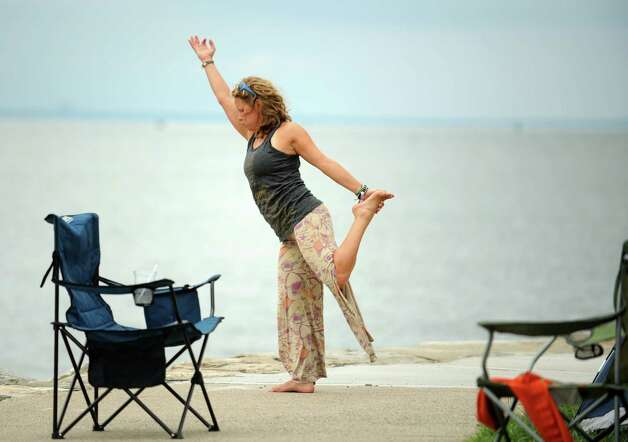 Katie Feinstein faces the Long Island Sound as she practices yoga at the annual Gathering of the Vibes Musical Festival at Seaside Park in Bridgeport, Conn. Friday, July 26, 2013. Photo: Autumn Driscoll / Connecticut Post freelance