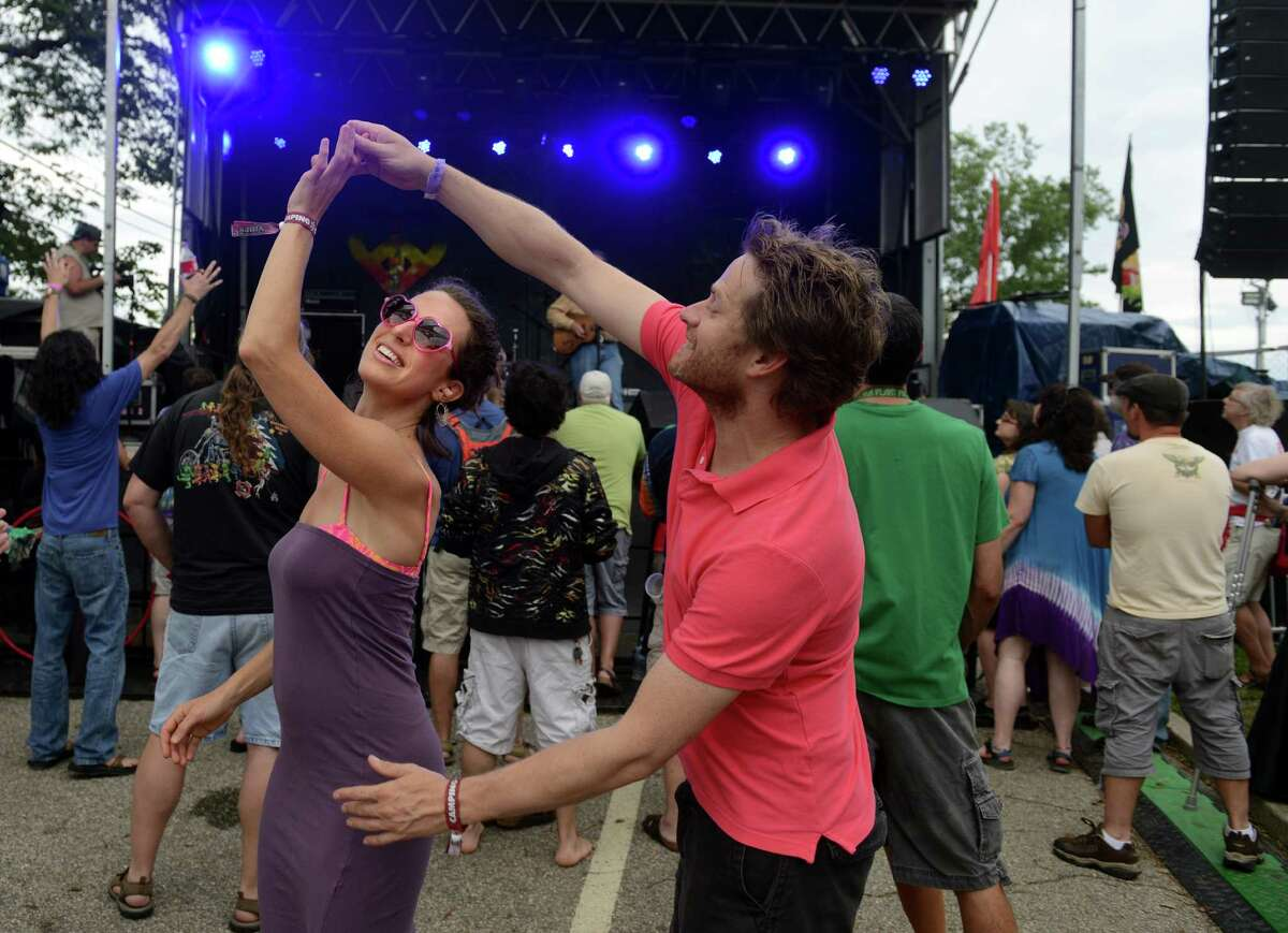 Kera Pesall and Trevor Cape, of Toronto, Ontario, Canada, dance together as David Gans performs on the Green Vibes stage during the 18th annual Gathering of the Vibes Musical Festival at Seaside Park in Bridgeport, Conn. Friday, July 26, 2013.