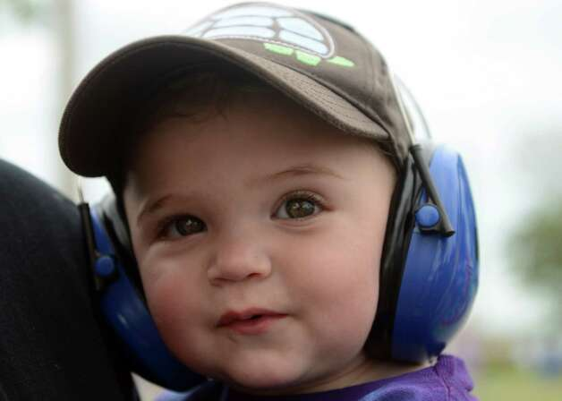 Fifteen-month-old Nathaniel Wilcox, of Statford, wears protective headphones as he listens to the music at the 18th annual Gathering of the Vibes Musical Festival at Seaside Park in Bridgeport, Conn. Friday, July 26, 2013. Photo: Autumn Driscoll / Connecticut Post freelance