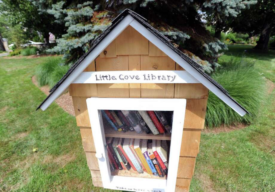 "Sue Rohrer's  new ""Little Cove Library,"" a pop-up library, that she has placed on her property at 3 Little Cove Place in Old Greenwich, Friday afternoon, July 26, 2013. Rohrer said anyone is welcome to take out books or add to the collection. Photo: Bob Luckey / Greenwich Time"