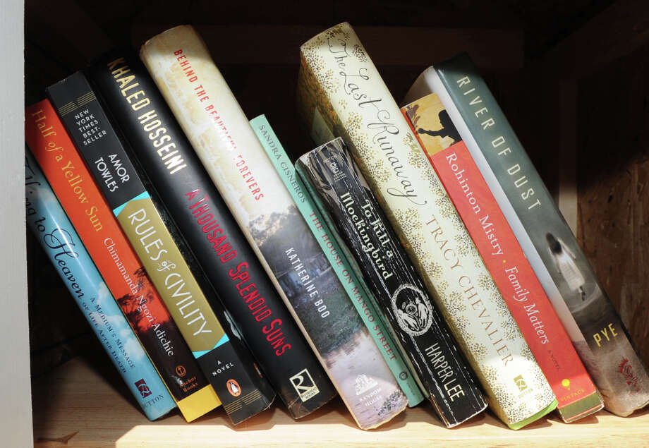 """Books on the shelf of Sue Rohrer's new """"Little Cove Library,"""" a pop-up library, that she has placed on her property at 3 Little Cove Place in Old Greenwich, Friday afternoon, July 26, 2013. Rohrer said anyone is welcome to take out books or add to the collection. Photo: Bob Luckey / Greenwich Time"""