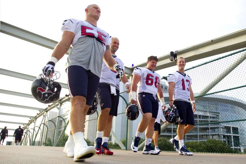 Chris Myers (55), Matt Schaub (8), Ben Jones (60) and T.J. Yates (13) walk across the Kirby bridge o