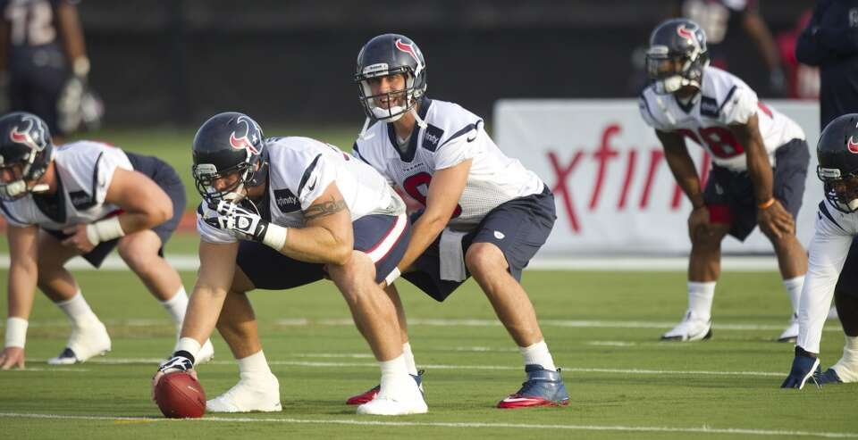 Quarterback Matt Schaub (8) lines up under center Chris Myers to run a play.