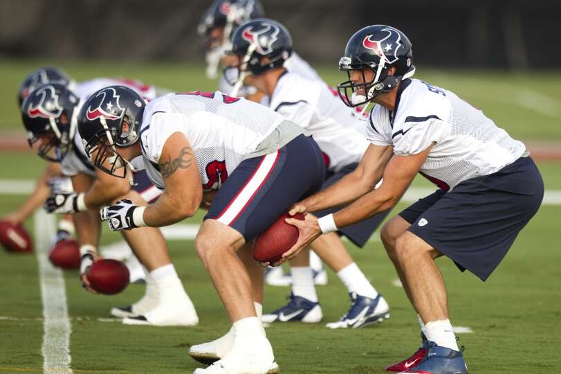 Quarterback Matt Schaub, right, takes a snap from center Chris Myers.