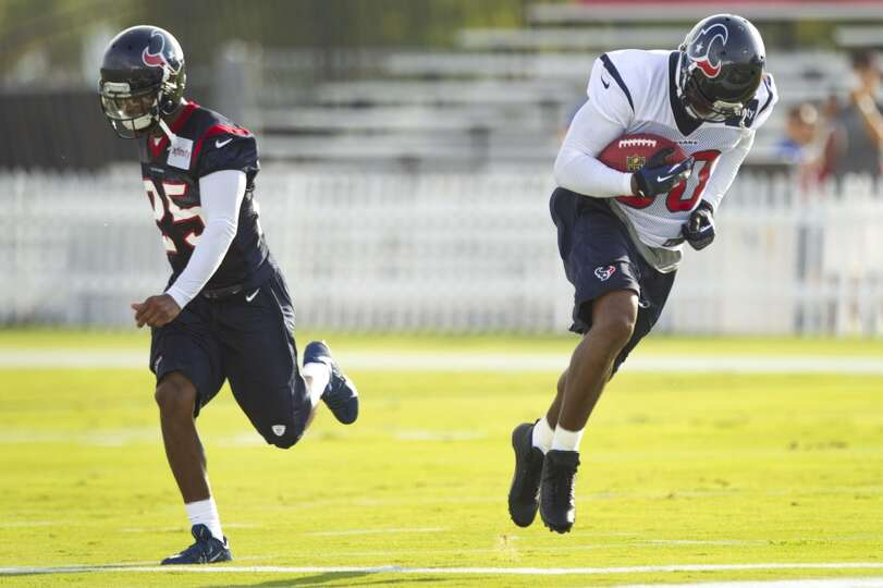 Wide receiver Andre Johnson (80) makes a catch against cornerback Kareem Jackson (25).
