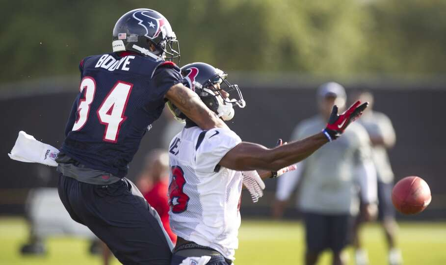 Cornerback A.J. Bouye (34) breaks up a pass intended for LeStar Jean (18).