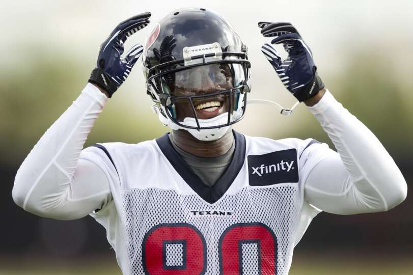 Wide receiver Andre Johnson smiles as he gets ready to run a drill.