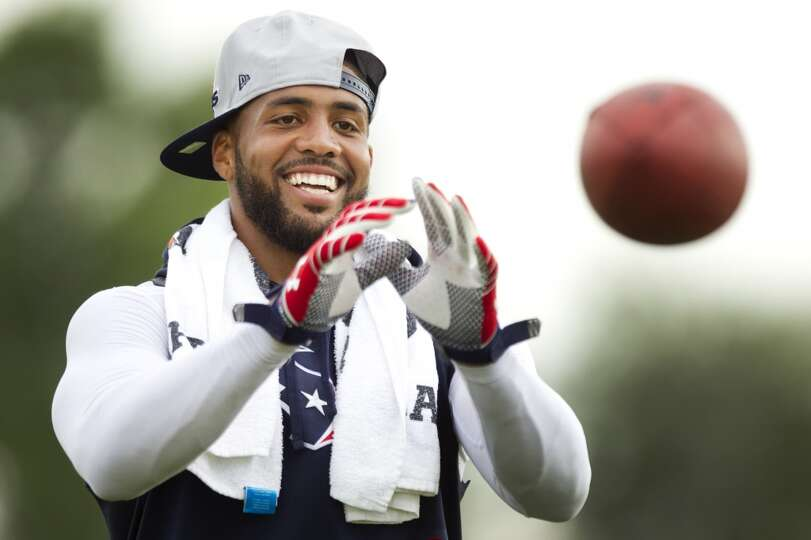 Running back Arian Foster reaches out to catch a ball.