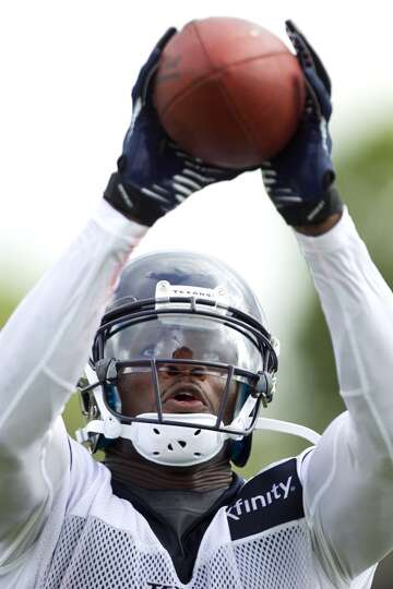 Wide receiver Andre Johnson reaches up to make a catch.