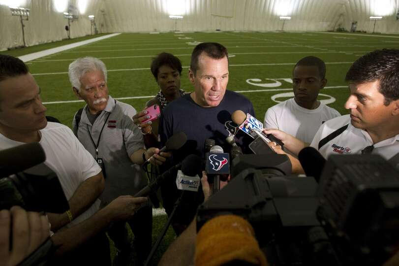 Head coach Gary Kubiak talks to the media following the first practice.