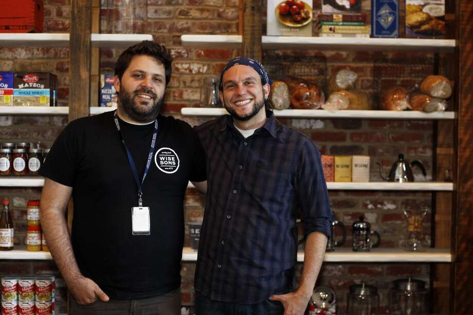 Co-owners Evan Bloom (left) and Leo Beckerman, in front of the retail shelves. Photo: Rohan Smith, The Chronicle