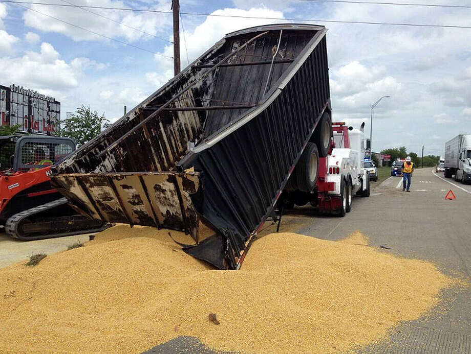 Portions of Spur 529 near U.S. 59 in Rosenberg were temporarily shut down after a big-rig lost a load of corn about noon Friday. The road remain blocked at 3:30 p.m.