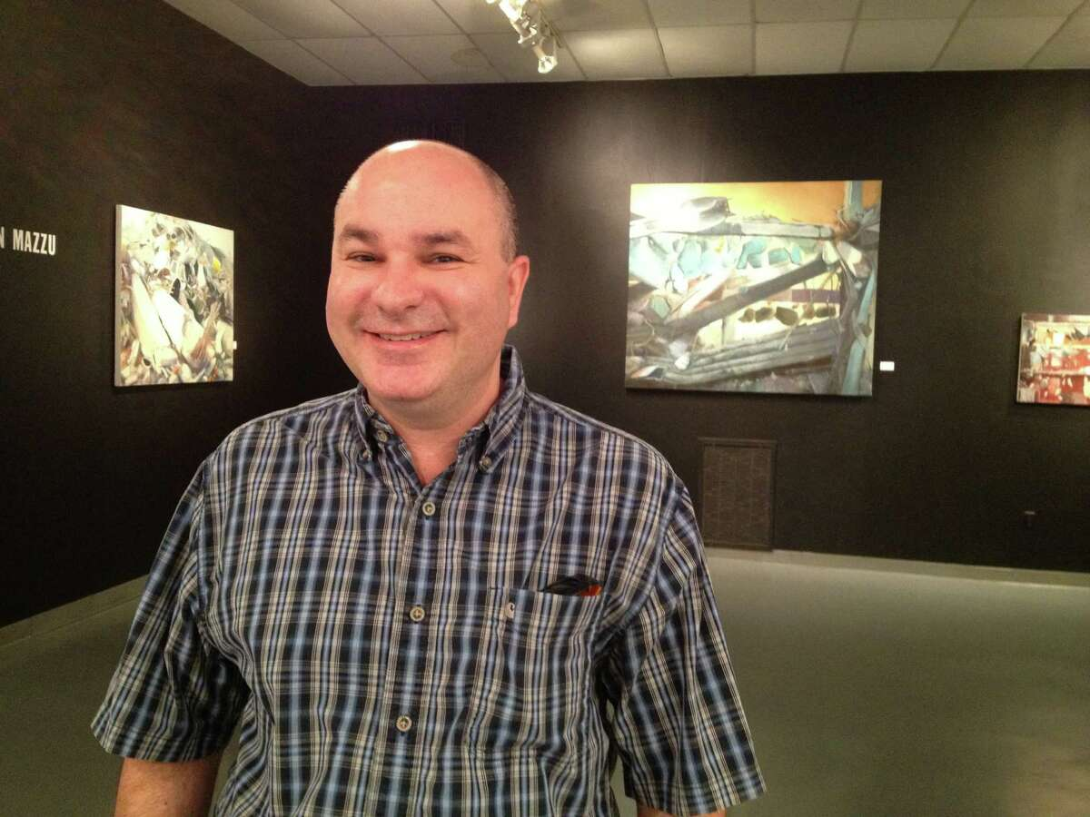 Artist Ken Mazzu at the Art Car Museum, where his recent paintings are on view.
